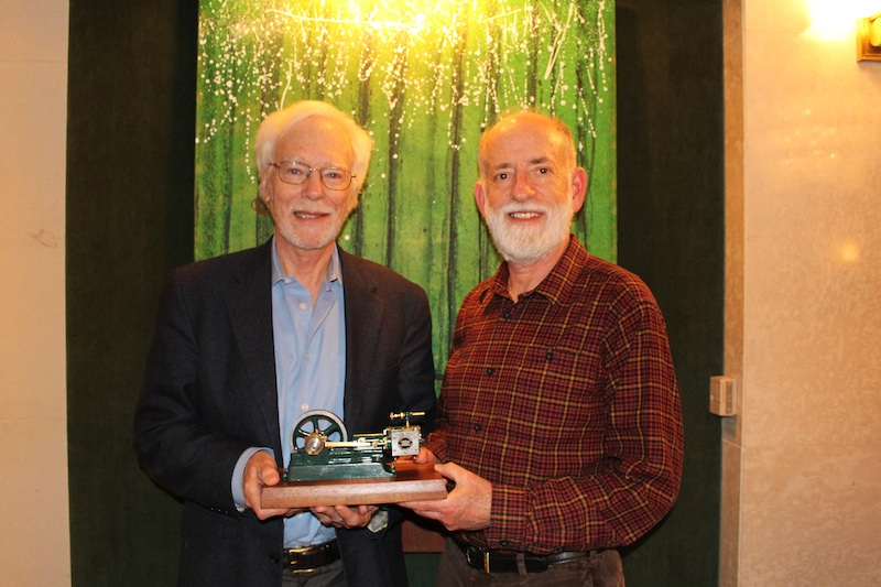 CRA Executive Director Andrew Bernat (left) presents CRA Board Chair (J Moore) with a gift for his term of service as CRA Board Chair (July 1, 2013 - June 30, 2015).